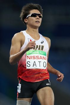 Keita Sato of Japan competes in heat 2 of the men's 100 meter T44 on day 1 of the Rio 2016 Paralympic Games at  on September 8, 2016 in Rio de Janeiro, Brazil.