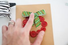 This craft is about making a greeting card with coat buttons glued as wreath.  Christmas Card Craft Idea #Christmas #Parenting PARENTING HEALTHY BABIES