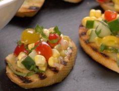 Close-up of corn and tomato relish topped bread slices
