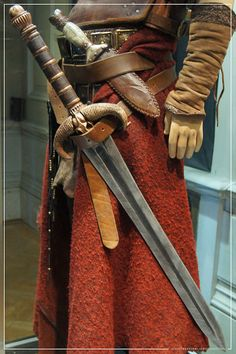 www.theestablishi...  Conan The Barbarian Exhibition - London Film Museum : Jason Momoa's Conan The Barbarian Leather Battle Armour, his father's The Sword of Corin & Dagger from Conan The Barbarian by Craig Grobler, via Flickr