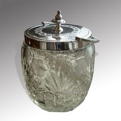 Late 19th century circular cut glass biscuit barrell with silver plated handle and lid. Extremely good cut glass decorated with flowers