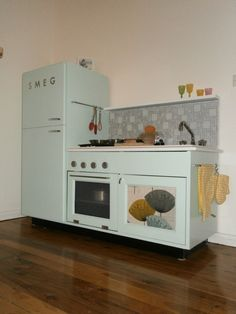 Retro kitchen. Made from an entertainment center like mine http://www.brotherstrimm.com/2012/10/the-ultimate-retro-kitchen.html
