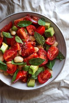 A Simple Tomato Salad (vegan caprese-inspired salad) | A salad for the height of Summer with garlicky beans, basil and avocado. Gluten free, grain free, dairy free.