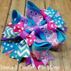 6 inch easter stacked twisted boutique bow on lined alligator clip rabbits foot prints https://www.facebook.com/1conniescustomcreations/