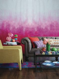 Pink painted #ombre wall with bold pops of #color. How awesome is that multi-colored coffee table #tray?