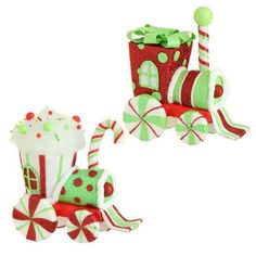 "RAZ Candy Train Christmas Ornaments Set of 2  2 Assorted trains Set includes one of each Color - red, lime, white Made of Polyfoam Measures 8"" X 7"" X 3.5"", 7.5"" X 7.5"" X 3.5""  Whimsical trains that can hang on your tree, or be used as tabletop pieces. One shaped with a cupcake like top, the other more square with a bow on top, large peppermint piece wheels. Very light in weight. 2014 RAZ Candy Sprinkles Collection"