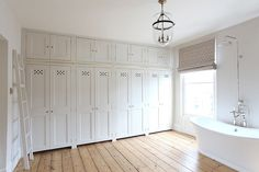 A wall of cabinets and drawers across from laundry machines. awesome option for family wardrobe storage. Wardrobe Storage, Built In Wardrobe, Closet Storage, Bedroom Storage, Sliding Wardrobe Doors, Closet Doors, Closet Redo, Glass French Doors, Bedroom Wardrobe
