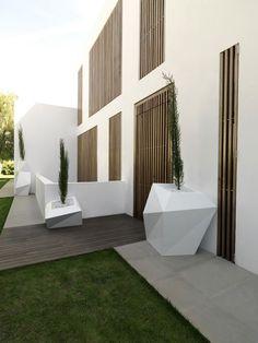 Wood and plaster. House in Rocafort by Ramon Esteve Studio.