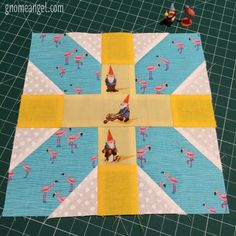 Fussy cut x plus quilt blocks by Angie Wilson of GnomeAngel.com