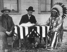 L-R: Billy Garnett, John S. Coldwell Jr., American Horse (Oglala) - 1907 {Note: John S. Coldwell Jr. (aka Jack Coldwell), a U.S. Allotting Surveyor with Billy Garnett acting as an Interpreter, are going through the process of making American Horse an American Citizen. It should be remembered that most Native American Indians did not receive American Citizenship status until 1927.