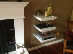 Home entertainment shelf system I built, all cables go down into the hollow shelf, out the back into a large circuit breaker type box on the other side of the wall (garage) which has a surge protecter, 110 outlet, and TV cable in, then up to TV above the mantel via pvc tubing.