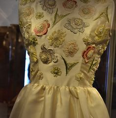 Detail of the bodice: embroidered with lilies of the valley and roses. Photo by Laura Emily.