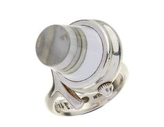 <b>A ROCK CRYSTAL WATCH RING BY GEORG JENSEN, VIVIAN TORUN BÜLOW-HÜBE</b> <br /> The manual wind ring watch with rock crystal quartz bezel, mounted in sterling silver, signed Georg Jensen, Torun, ring size N-O, accompanied by a Georg Jensen box. <br />