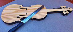 Tabla con forma de violín, en: www.lavitamusicgifts.blogspot.com