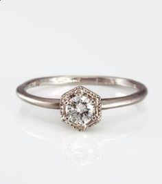 No where close to wedding times, but I love the simple band on this ring but maybe could do without the hexagon
