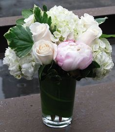 Creamy South American Roses paired with soft white Hydrangeas create a sweet and versatile fresh cut flower arrangement.