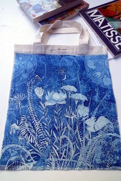 A stunning tote is printed with a botanical aquatint etching.