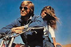 """lovecovetdream:  """" Love: the carefree, denim clad glamour of the 1970s  Beautiful people - Robert Redford and Lauren Hutton  """""""
