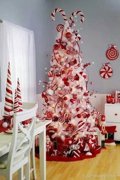 Festive red and white candy cane Christmas tree. Go all out this season with…