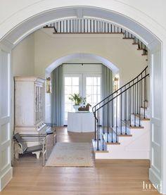 Transitional White Paneled Foyer