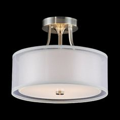 Give your home a sleek and modern update with this three-light flush-mount chandelier. This chandelier features a semi-transparent, off-white shade that gives off soft lighting. The chandelier is completed with a satin nickel finish.
