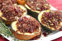 Roasted Acorn Squash Stuffed With Quinoa Mushroom Pilaf. This could serve as a vegan alternative to the turkey this Thanksgiving