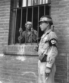 A South Korean soldier on guard at Taegu mission school, which served as a POW camp during the Korean War