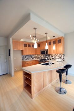 1. The lamp 2. The rounded kitchen peninsula countertop is child-friendly
