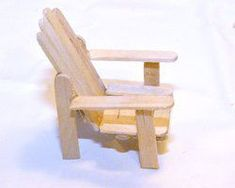 Make a popsicle stick Adirondack Chair (aka Muskoka Chair) for your fairy garden or dollhouse yard.  This has two slats on top of the seat - I would put them on the underside.