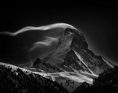 Captured elegantly in black and white, the Matterhorn, one of the highest mountain peaks in the Pennine Alps, reaches toward the starry night sky in this photo, shot by Nenad Saljic. The picture won First Place in the Places category of the 2012 National Geographic Photography Contest.