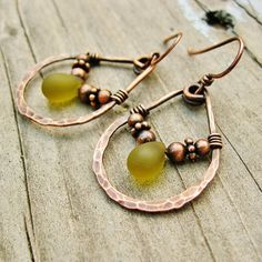 This is a fun pair of earrings - antiqued copper beads and olive green Czech Picasso glass drops are wire wrapped through the center. The beads