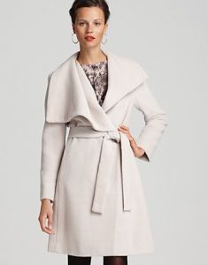 165bf475605 Calvin Klein offers a stylish alternative to the Ferragamo blush pink shawl  collar coat and is