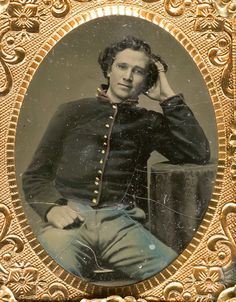 *FACES of the CIVIL WAR~ HANDSOME YOUNG SOLDIER. 1/9 plate tintype in geometric thermoplastic case. Sharply gilded buttons, with red on his collar, his trousers blue. He is appealing in this nice casual pose.