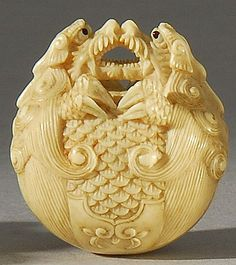 "Lot 67: IVORY NETSUKE By Kyusai. Depicting a mokugyo bell with double dragon finial. Each dragon with inlaid eyes. Signed ""Tetsugendo"". - Eldred's 