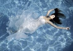 photo by klaus mellenthin / model: stefanie daut / retouching: dirk heintz #mallorca #pool #bridalwear #bridal