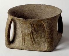 Bowl decorated with two ibex in relief Beth Shean Valley Early Bronze Age, 3500-3000 BCE Basalt Israel Antiquities Authority