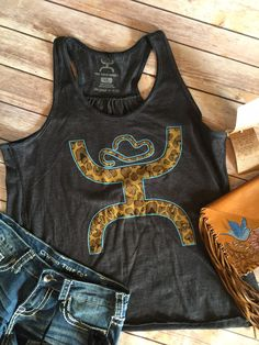 Just in from Hooey!! Womens black tank with cheetah hooey logo. Super soft and comfy Small- 4-6, Medium 8-10, Large 12-14, Xlarge 16-18 Classy Cowgirl Co- Gyp