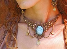 This is a macrame necklace that I made, I used in hie quality Labradorite stone and brass beads Made with love <3  Primitivecraft.etsy.com