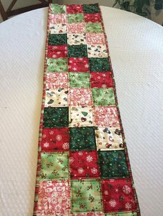 Enjoy your festive Holiday season with this gorgeous table runner!    Fabrics are great quality, I used a patchwork pattern. All fabrics