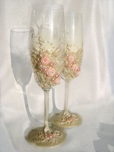 Beautiful wedding champagne glasses in blush pink and ivory, elegant toasting flutes with pearls and roses. $58.00, via Etsy.