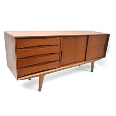 "Emory sideboard in Teak - The Emory Sideboard is made of solid Teak wood, featuring high quality handmade craftsmanship. Architecturally clean and simple lines, detailed handles and defined drawers make this piece timeless by design. Plenty of interior storage and adjustable shelving makes it highly versatile in use. 30.0"" x 69.0"" x 17.5"" price: $1,995"