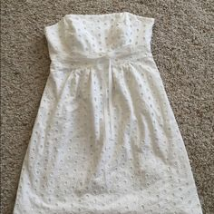 Lilly Pulitzer eyelet dress ☀️ The definition of summer! This item is in good condition but it has been worn please ask any questions before purchasing. This item will only be traded for an autographed Authentic Chanel original, a Lamborghini, a penthouse in Paris, or the services of an Audi mechanic. Offers submitted in comments will be ignored Lilly Pulitzer Dresses