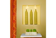 This niche, vase, and colorful artistic visual becomes an alter to your goals. The goal for health is represented by the plants, the three vases represent the hope for a family, and the color and light stimulates the chi and fame bagua area of the home.   - Project by Kim Colwell Design