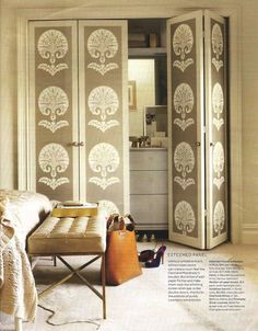 large repeat wallpaper to cover closet doors - love the staged interior dressing space as well