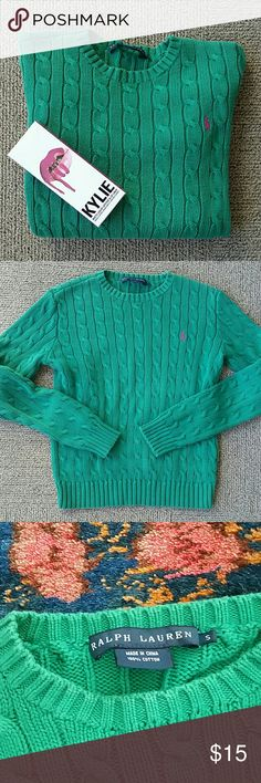 Ralph Lauren Cable Knit Sweater Reposhing -- was just a little too short for me! Never worn by me, and arrived in great condition from the previous owner. The third photo with the tag reflects the color most accurately. It's a rich true green with a pink logo -- perfectly preppy! Best if you don't have a very long waist, or if you don't mind your sweaters a little shorter. Real Ralph Lauren (not one of the cheaper lines like Lauren Ralph Lauren or Polo). Just trying to get my money back…