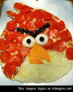 Angry Birds Pizza - Olives and mushroom caps make the eyes, and a slice of cheddar is cut to make the beak!