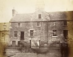 Scouring Burn in Dundee - 1877, at Malcolm's Pend.  Love the people gathered at the edges, and the two kids in the doorway to the right.