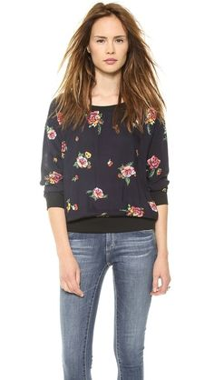 Ashbury Blooms Woven Top: The sweatshirt styling makes it an easy fit for everyone.