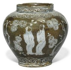 SAFAVID POTTERY VASE IRAN, 17TH CENTURY Of bulbous form with straight neck, the white slip decoration with standing figures meeting in a Chinese-style landscape painted on brown slip under light blue transparent glaze, intact 4¼in. (10.5cm.) high