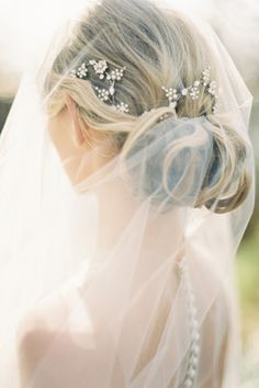 Not sure how I feel about the pins in the hair, but I like the sheer veil and how it attaches to the low bun.